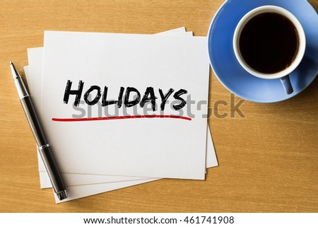 Holidays - handwriting on papers with cup of coffee and pen, holidays concept