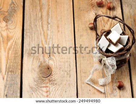 Holidays, love, food and drink concept. Handmade cookies in a basket on a wooden table in a vintage style. Selective focus, copy space background - stock photo