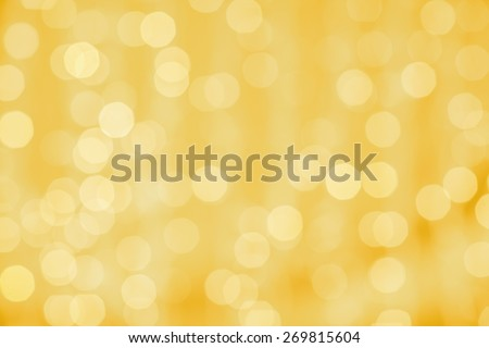 holidays, party and celebration concept - blurred golden background with bokeh lights - stock photo
