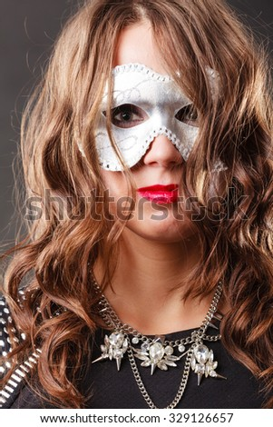 Holidays, people and celebration concept. Woman with carnival venetian mask closeup