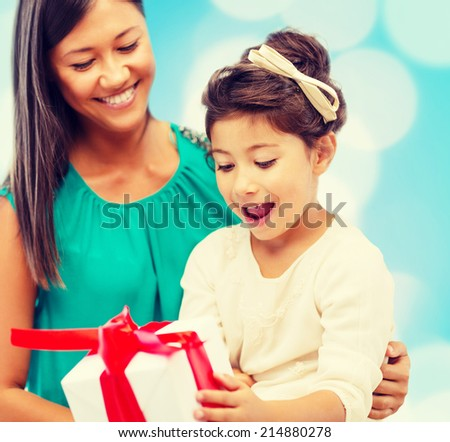 holidays, presents, christmas, birthday concept - happy mother and child girl with gift box