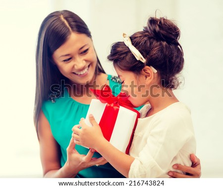 holidays, presents, christmas, x-mas and birthday concept - happy mother and child girl with gift box - stock photo
