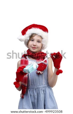 holidays, presents, Christmas, x-mas, birthday concept - happy little girl opening gift box over light background