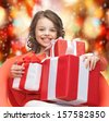 holidays, presents, christmas, x-mas concept - happy child girl with gift boxes - stock photo
