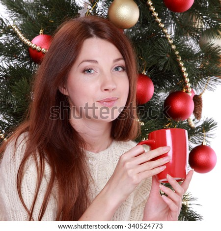 holidays, presents, christmas, x-mas concept - happy girl over Christmas tree/Studio portrait of attractive smiley young woman on Holiday theme