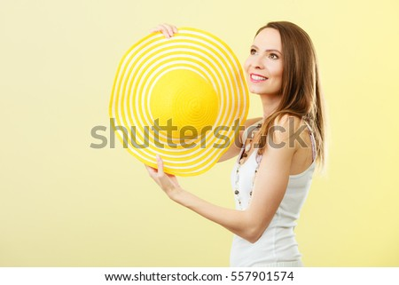 Holidays summer fashion and head protection. Woman in big yellow hat. Portrait of charming female on bright background.