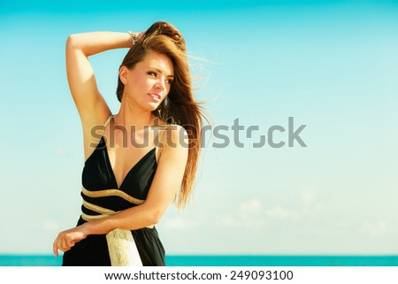 Holidays, summertime travel and freedom concept. Portrait of lovely girl beauty long hair outdoor. Young pretty tanned woman in summer clothing on sky background - stock photo