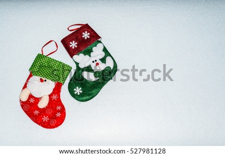 Holidays symbol stockings. Christmas socks on a light background. Christmas background with copy space