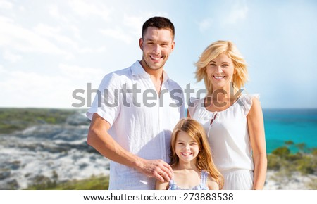holidays, travel, tourism and people concept - happy family over summer beach background - stock photo