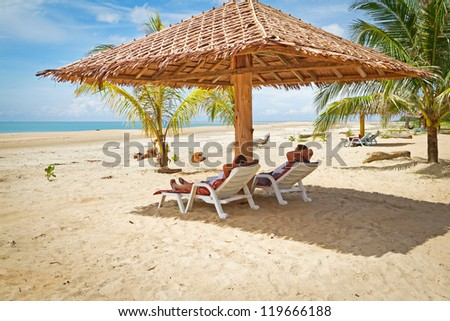 Holidays under parasol at Andaman Sea - stock photo