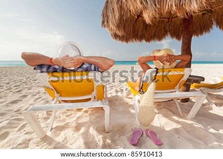 Holidays under parasol at Caribbean Sea - stock photo