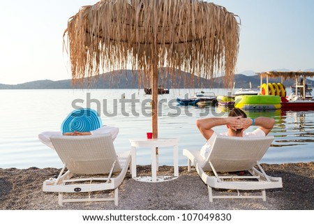 Holidays under parasol in Greece - stock photo