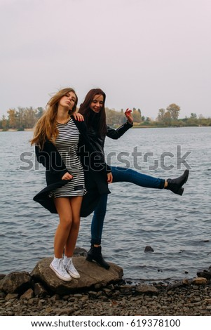 holidays, vacation, love and friendship concept - smiling teen women young cheerful hipster Best Friends bff having fun, played outdoors, mimic fight, positive emotions, having fun dancing outdoors