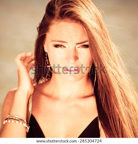 Holidays, vacation travel and freedom concept. Portrait of lovely girl beauty long hair on seaside. Young pretty tanned woman in summer clothing on blue water background