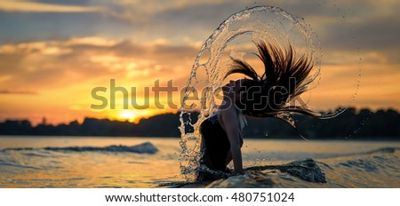 Holidays water expression of young brunette