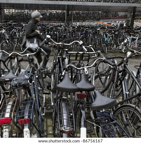 Holland, Amsterdam, bicycles parking near the Central Station - stock photo