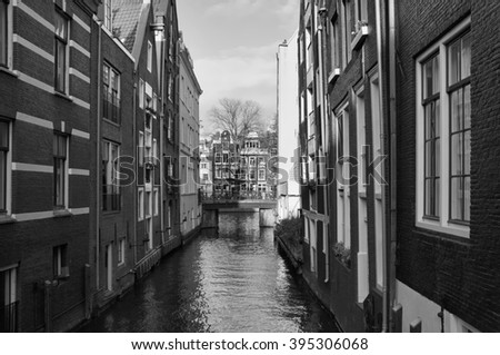 Holland, Amsterdam, old stone houses on a water channel