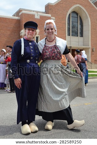 HOLLAND, MI - MAY 3: Tulip Time Festival dancers pose after performing the mother daughter dance in Holland, MI May 3, 2015.  - stock photo