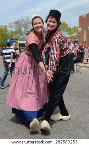 HOLLAND, MI - MAY 3: Tulip Time Festival dancers pose after performing the mother-daughter dance in Holland, MI May 3, 2015.