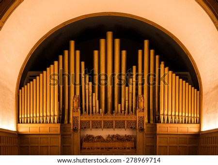 HOLLAND, MICHIGAN - MAY 12: Pipe organ inside the Hope Church on May 12, 2015 in Holland, Michigan - stock photo