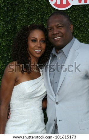Holly Robinson Peete and Rodney Peete at the CBS, The CW, Showtime Summer Press Tour Party, Beverly Hilton Hotel, Beverly Hills, CA. 07-28-10