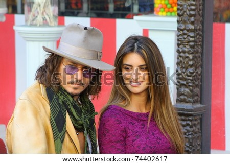 HOLLYWOOD - APRIL 1: Actors Penelope Cruz and Johnny Depp at Cruz's star on the Walk of Fame ceremony on April 1, 2011 Hollywood, CA. - stock photo