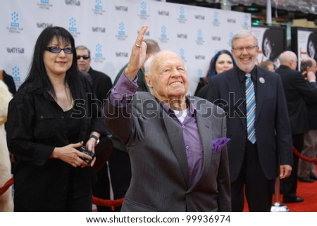 HOLLYWOOD - APRIL 12, 2012: Veteran actor Mickey Rooney(c) walks the red carpet for opening night of the TCM Classic Film Festival held at Grauman's Chinese Theatre in Hollywood, CA April 12, 2012 - stock photo