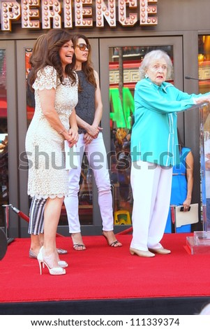 HOLLYWOOD - AUGUST 22, 2012: Actor Betty White(r) joins Valerie Bertinelli(l) on stage at Hollywood Walk of Fame for Valerie August 22, 2012 Hollywood, CA - stock photo