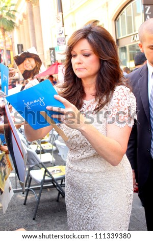 HOLLYWOOD - AUGUST 22, 2012: Actor Valerie Bertinelli signs autographs after ceremony to receive a star on Hollywood Walk of Fame August 22, 2012 Hollywood, CA - stock photo