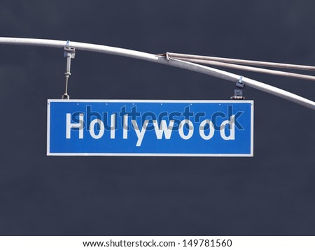 Hollywood Blvd overhead street sign with dark storm sky. - stock photo