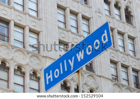 Hollywood boulevard sign with the building background - stock photo