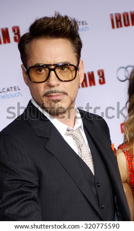"HOLLYWOOD, CA - APRIL 20, 2013: Robert Downey Jr. at the Los Angeles premiere of ""Iron Man 3"" held at the El Capitan Theater in Los Angeles, USA."