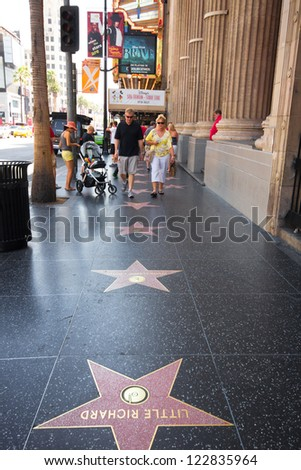 HOLLYWOOD, CA - AUG 11: Stars on the Hollywood Walk of Fame on Hollywood Blvd in Los Angeles, CA on Aug. 11, 2012. 2400 stars pay tribute artists who have made contributions in entertainment. - stock photo