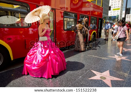 HOLLYWOOD, CA - AUG 11: View of  the Hollywood Walk of Fame on Hollywood Blvd in Los Angeles, CA on Aug. 11, 2012. 2400 stars pay tribute artists who have made contributions in entertainment. - stock photo