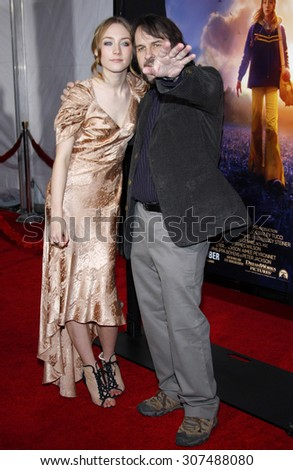HOLLYWOOD, CA - DECEMBER 07, 2009: Saoirse Ronan and Peter Jackson at the Los Angeles premiere of 'The Lovely Bones' held at the Grauman's Chinese Theater in Hollywood, USA on December 7, 2009. - stock photo