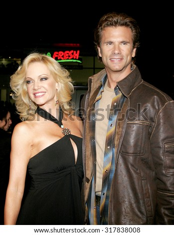 HOLLYWOOD, CA - FEBRUARY 02, 2006: Barbara Moore and Lorenzo Lamas at the World premiere of 'Firewall' held at the Grauman's Chinese Theatre in Hollywood, USA on February 2, 2006. - stock photo