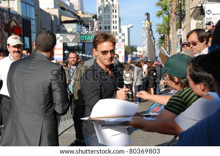 "HOLLYWOOD, CA- JUNE 18: Actor Thomas Kretschmann attends the Disney's Pixar ""Cars 2"" premiere, held at El Capitan Theatre, June 18, 2011 in Hollywood,CA. - stock photo"