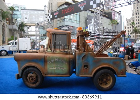 "HOLLYWOOD, CA- JUNE 18: Character Tow Mater arrives at Disney's Pixar ""Cars 2"" premiere, held at El Capitan Theatre, June 18, 2011 in Hollywood,CA. - stock photo"