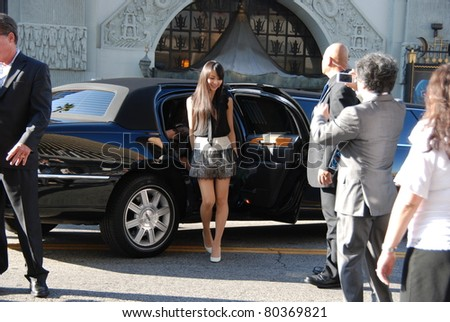"HOLLYWOOD, CA- JUNE 18: Singer Kashiyuka from Japanese band ""Perfume"" attends the Disney's Pixar ""Cars 2"" premiere, held at El Capitan Theatre, June 18, 2011 in Hollywood,CA. - stock photo"