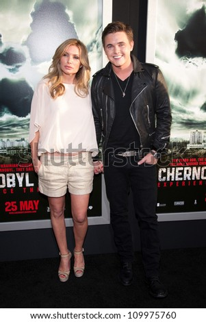 HOLLYWOOD, CA - MAY 23: Jesse McCartney and guest arrive at the Special Fan Screening of Chernobyl Diaries at the Cinerama Dome on May 23, 2012 in Hollywood, California. - stock photo