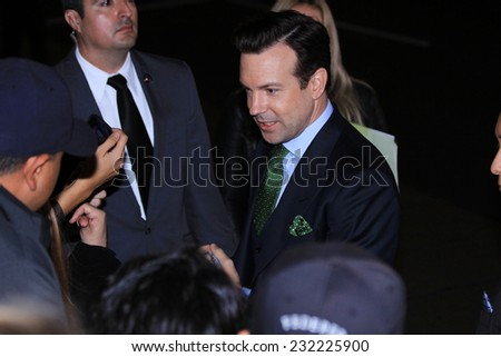 "HOLLYWOOD CA - NOVEMBER 20, 2014: Actor Jason Sudeikis chats with fans at ""Horrible Bosses 2"" premiere at the TCL Chinese Theatre November 20, 2014 Hollywood, CA. - stock photo"