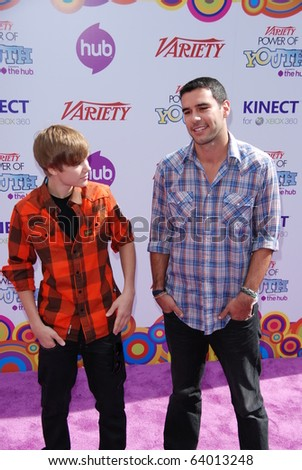 HOLLYWOOD, CA-OCTOBER 24: (L-R)Singer Justin Bieber and his manager Scooter Braunattend the 4th annual Variaty's Power Of Youth even at Paramount Studios on October 24, 2010 in Hollywood, California.