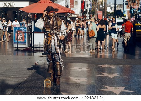HOLLYWOOD, CA - SEPTEMBER 7: Stars on the Hollywood Walk of Fame on Hollywood Blvd in Los Angeles, CA on September 7, 2013. 2400 stars pay tribute artists who have made contributions in entertainment. - stock photo