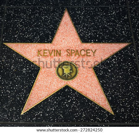 HOLLYWOOD, CA/USA - APRIL 18, 2015: Kevin Spacey star on the Hollywood Walk of Fame. The Hollywood Walk of Fame is made up of  brass stars embedded in the sidewalks on Hollywood Blvd.