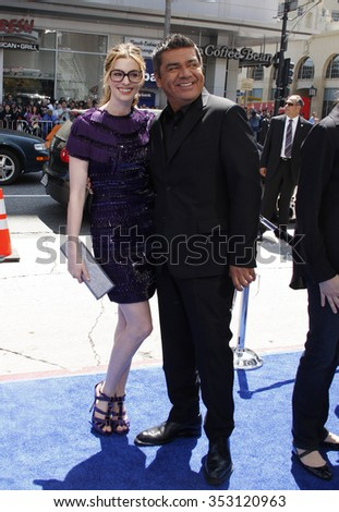 "HOLLYWOOD, CALIFORNIA - April 10, 2011. Anne Hathaway and George Lopez at the Los Angeles premiere of ""Rio"" held at the Grauman's Chinese Theater in Los Angeles."
