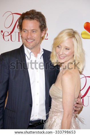 HOLLYWOOD, CALIFORNIA - April 20, 2012. Anne Heche and James Tupper at the 17th Annual Taste For A Cure Gala held at the Beverly Wilshire Four Seasons Hotel, Los Angeles.