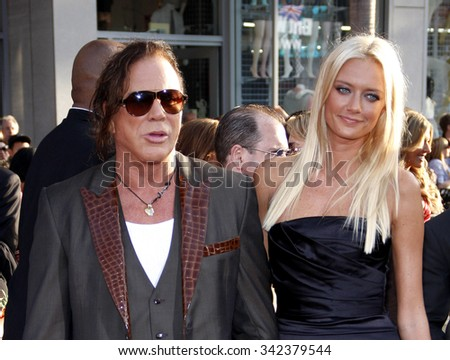 "HOLLYWOOD, CALIFORNIA - April 26, 2010. Mickey Rourke and Anastassija Makarenko at the World premiere of ""Iron Man 2"" held at the El Capitan Theater, Hollywood."