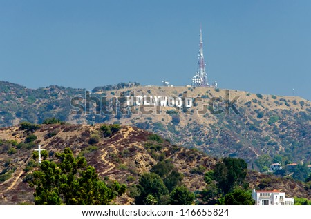 HOLLYWOOD, CALIFORNIA - CIRCA AUGUST 2012 - Hollywood sign on Santa Monica mountains in Los Angeles, USA, circa August 2012. It was originally created as advertisement for real estate development.  - stock photo