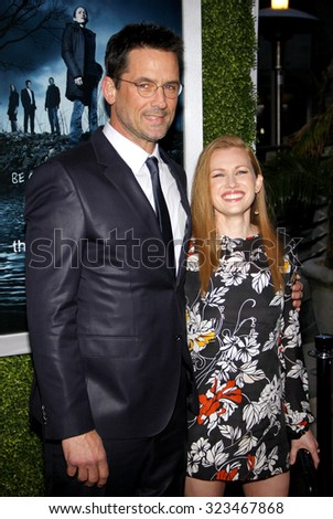 HOLLYWOOD, CALIFORNIA - March 26, 2012. Mireille Enos and Billy Campbell at the Los Angeles Season 2 premiere of AMC's 'The Killing' held at the ArcLight Cinemas in Hollywood. - stock photo