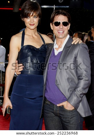 "HOLLYWOOD, CALIFORNIA - Monday August 11, 2008. Katie Holmes and Tom Cruise at the Los Angeles Premiere of ""Tropic Thunder"" held at the Mann Village Theater, Westwood. - stock photo"